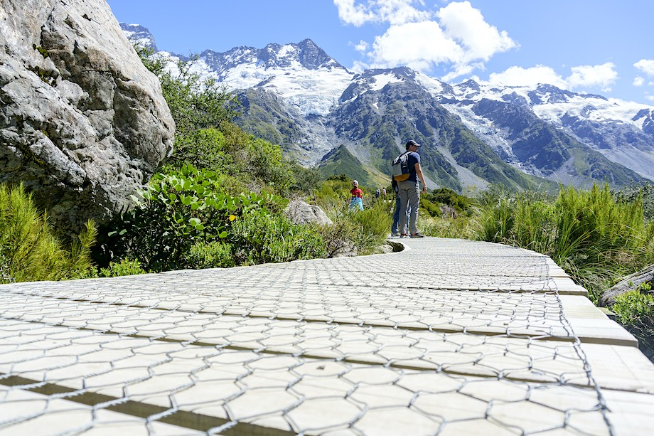 Mount Cook New Zealand - February 16 2015; Tourists stop to look at view on wooden walkway on Hooker Valley Walk in South Island, New Zealand.
