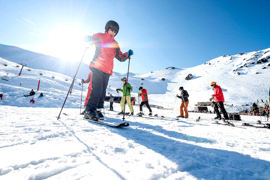 Six skiiers are pictured on flat snow at Mount Hutt.