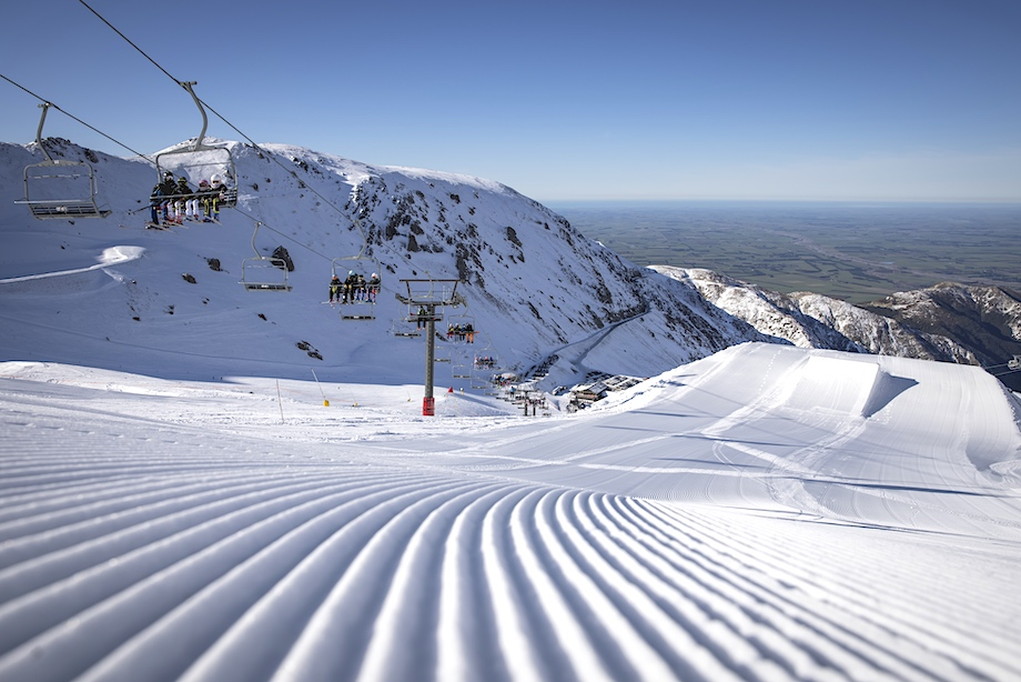 Mount Hutt. Ski slopes taken from a high view point with ski lift ascending on left of image.